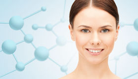 Beautiful young woman face with molecules Royalty Free Stock Image