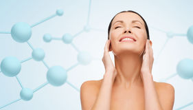 Beautiful young woman face with molecules royalty free stock images