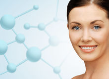 Beautiful young woman face with molecules royalty free stock photos