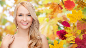 Beautiful young woman face over autumn leaves Royalty Free Stock Photography