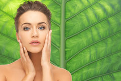 Beautiful young woman face over green background Royalty Free Stock Image