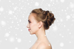 Beautiful young woman face over snow Royalty Free Stock Photo