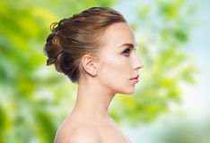 Beautiful young woman face over white background Royalty Free Stock Photos