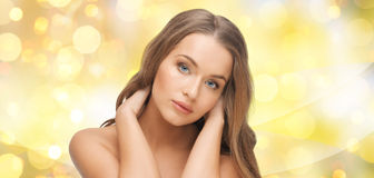 Beautiful young woman face over yellow lights Royalty Free Stock Photography