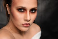 Beautiful Young Woman, Face shot on Dark Grey Background stock photo