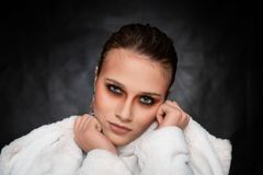 Beautiful Young Woman, Face shot on Dark Grey Background royalty free stock images