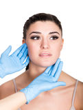 Beautiful young woman face and syringe making injection. Isolated over white background. Stock Photo