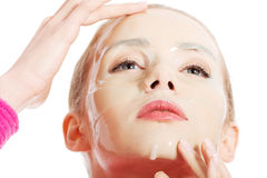 Beautiful young woman with facial mask. Spa concept. Royalty Free Stock Photography