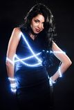 Beautiful young woman with fairy lights Stock Image