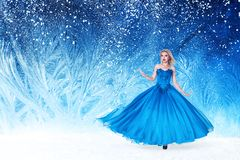 Beautiful woman in fairy tale forest. Beautiful young woman in fairy tale forest with long luxurious dress Stock Image