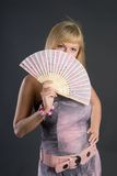 Beautiful young woman with fan Stock Image