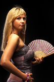 Beautiful young woman with fan Royalty Free Stock Images