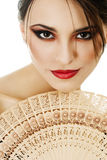 Beautiful young woman with fan isolated Royalty Free Stock Photography