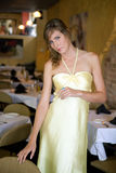 Beautiful Young Woman in Fancy Restaurant. A portrait of a gorgeous, elegant woman standing in a nice restaurant Royalty Free Stock Photo