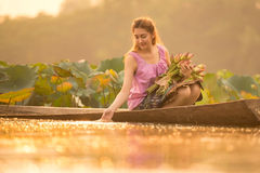 Beautiful young woman Farmer collecting lotus. In garden. thai lifestyle people in local,Thailand stock photos