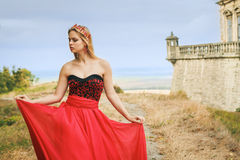Beautiful young woman in fashion red dress Royalty Free Stock Image