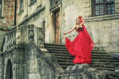 Beautiful young woman in fashion red dress Stock Images