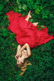 Beautiful young woman in fashion red dress Royalty Free Stock Photography