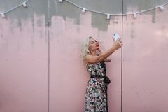 Beautiful young woman in fashionable vintage dress takes stock photography