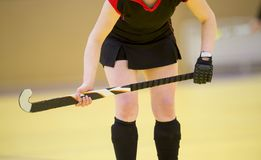 A beautiful young woman field hockey player royalty free stock photography