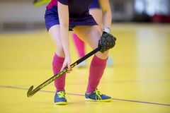 A beautiful young woman field hockey player royalty free stock images