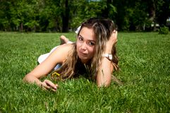 Beautiful young woman on field in summer Stock Photo