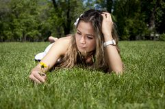 Beautiful young woman on field in summer Royalty Free Stock Images