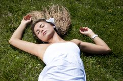 Beautiful young woman on field in summer Stock Photos