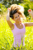 Beautiful young woman on field in summer Royalty Free Stock Photos