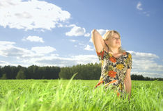 Beautiful young woman on field  in summer time Stock Photos