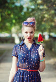 Beautiful young woman in fifties style with candy Royalty Free Stock Image
