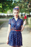 Beautiful young woman in fifties style with candy Stock Image