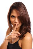 Beautiful young woman finger on lips for secret Stock Photo