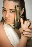 The beautiful young woman with fire-arms in hands. The young beautiful woman with fire-arms in hands Royalty Free Stock Images