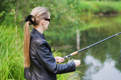 The beautiful young woman on fishing Stock Images