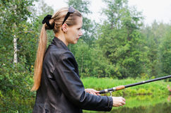 The beautiful young woman on fishing Royalty Free Stock Images