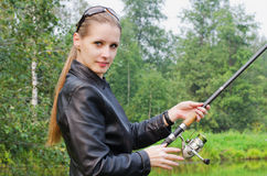 The beautiful young woman on fishing Stock Photos