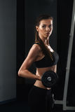 Beautiful young woman during fitness with Royalty Free Stock Photography