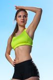 Beautiful young woman in fitwear outdoors Stock Images