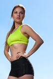 Beautiful young woman in fitwear outdoors Royalty Free Stock Image