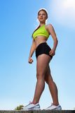 Beautiful young woman in fitwear outdoors Stock Photos