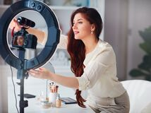 Free Beautiful Young Woman Fix Thr Ring Light Before Streaming A Beauty Vlog From Home, Online Content Creator Applying A Makeup On Royalty Free Stock Images - 216065129