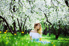 Beautiful young woman in floral maxi skirt walking in spring Royalty Free Stock Photography