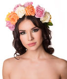 Beautiful young woman with floral wreath. Fashion shot. Closeup portrait. Fashion jewelry. Beauty portrait. Stock Images