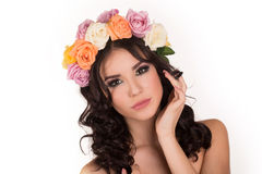 Beautiful young woman with floral wreath. Fashion shot. Closeup portrait. Fashion jewelry. Beauty portrait. Royalty Free Stock Photo