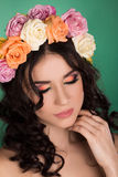 Beautiful young woman with floral wreath. Fashion shot. Closeup portrait. Fashion jewelry. Beauty portrait. Royalty Free Stock Image