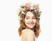 Beautiful young woman in a floral wreath of roses Royalty Free Stock Photos