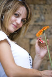 Beautiful young woman with flower Stock Images