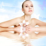 Beautiful young woman with flower royalty free stock photo