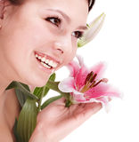 Beautiful young woman with flower. Stock Photography